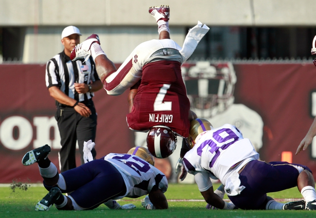 Sep 7, 2013; Starkville, MS, USA;  Alcorn State defensive back Jamie Knox (22) and linebacker Jestin Williams (39) flip Mississippi State Bulldogs running back Nick Griffin (7) at Davis Wade Stadium.  The Bulldogs defeated the Braves 51-7. Mandatory Credit: Marvin Gentry-USA TODAY Sports