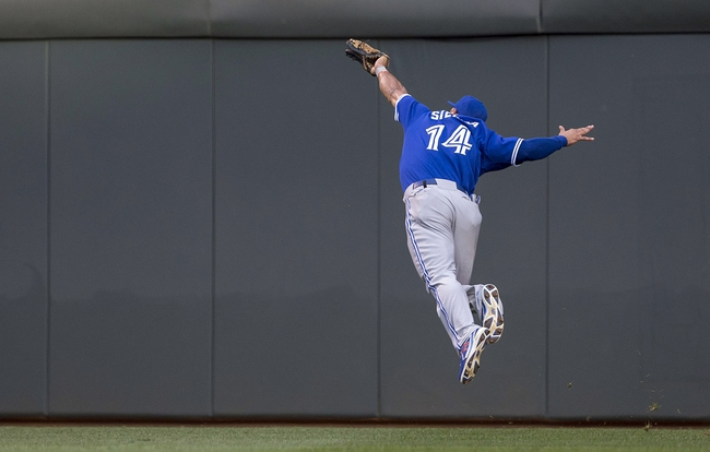 Sep 7, 2013; Minneapolis, MN, USA; Toronto Blue Jays right fielder Moises Sierra (14) reaches out to catch a fly ball in the first inning against the Minnesota Twins at Target Field. Mandatory Credit: Jesse Johnson-USA TODAY Sports