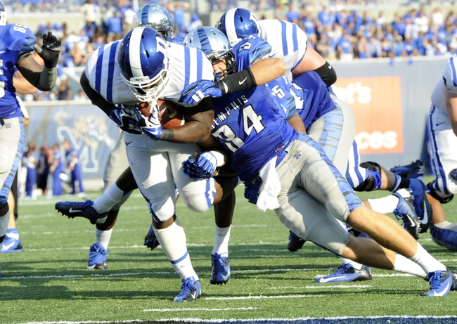 Sep 7, 2013; Memphis, TN, USA;Duke Blue Devils running back Juwan Thompson (23) carries the ball against the Memphis Tigers at Liberty Bowl Memorial. Mandatory Credit: Justin Ford-USA TODAY Sports