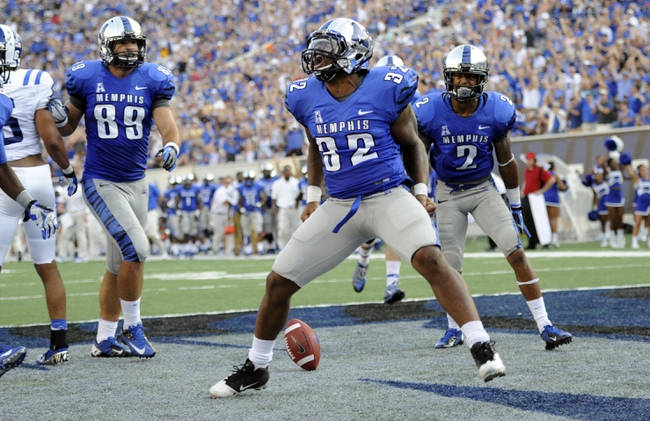 Sep 7, 2013; Memphis, TN, USA; Memphis Tigers running back Jai Steib (32) reacts after scoring a touchdown against the Duke Blue Devils at Liberty Bowl Memorial. Mandatory Credit: Justin Ford-USA TODAY Sports