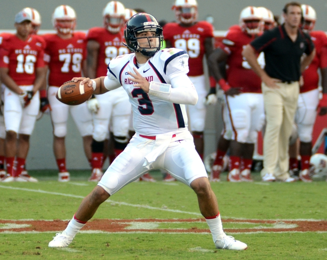 Sep 7, 2013; Raleigh, NC, USA; Richmond Spiders quarterback Michael Strauss (3) throws a pass against the North Carolina State Wolfpack at Carter Finley Stadium. Mandatory Credit: Rob Kinnan-USA TODAY Sports