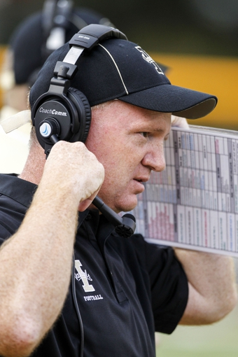 Sep 7, 2013; Laramie, WY, USA; Idaho Vandals head coach Paul Petrino reacts against the Wyoming Cowboys during the fourth quarter at War Memorial Stadium. The Cowboys defeated the Vandals 42-10. Mandatory Credit: Troy Babbitt-USA TODAY Sports