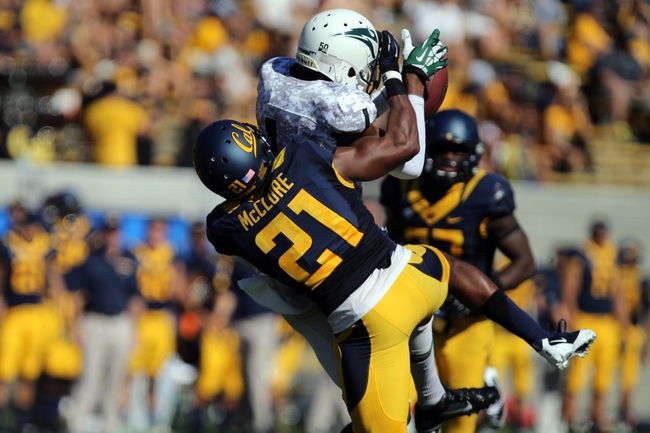 Sep 7, 2013; Berkeley, CA, USA; Portland State Vikings wide receiver Victor Dean catches the pass against California Golden Bears defensive back Stefan McClure (21) during the third quarter at Memorial Stadium. Mandatory Credit: Kelley L Cox-USA TODAY Sports