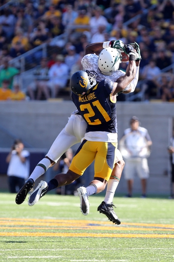 Sep 7, 2013; Berkeley, CA, USA; California Golden Bears defensive back Stefan McClure (21) breaks up the pass intended for Portland State Vikings wide receiver Victor Dean (1) during the third quarter at Memorial Stadium. Mandatory Credit: Kelley L Cox-USA TODAY Sports