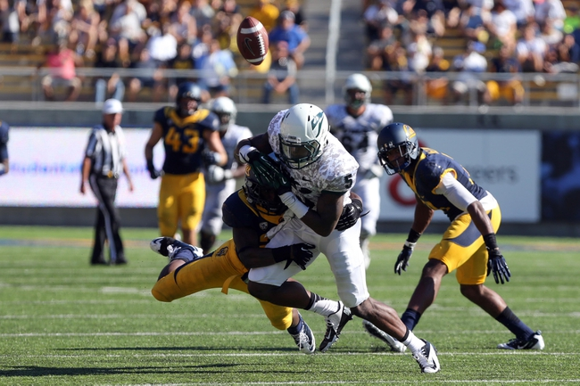 Sep 7, 2013; Berkeley, CA, USA; California Golden Bears defensive back Damariay Drew (27) tackles Portland State Vikings wide receiver Roston Tatum (5) later ruled as an incomplete pass during the third quarter at Memorial Stadium. Mandatory Credit: Kelley L Cox-USA TODAY Sports