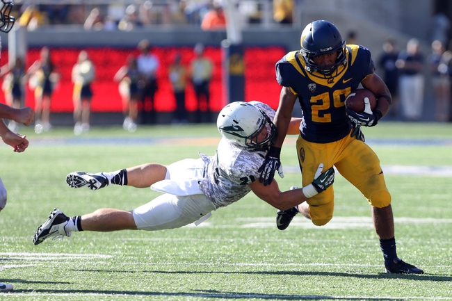 Sep 7, 2013; Berkeley, CA, USA; California Golden Bears running back Khalfani Muhammad (29) carries the ball as Portland State Vikings safety Dean Faddis (21) wraps up for the tackle during the third quarter at Memorial Stadium. Mandatory Credit: Kelley L Cox-USA TODAY Sports
