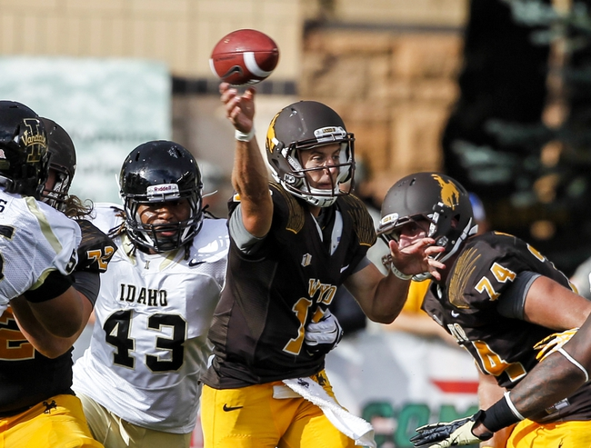 Sep 7, 2013; Laramie, WY, USA; Wyoming Cowboys quarterback Brett Smith (16) throws against the Idaho Vandals during the third quarter at War Memorial Stadium. The Cowboys defeated the Vandals 42-10. Mandatory Credit: Troy Babbitt-USA TODAY Sports
