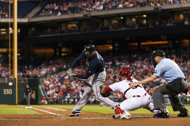 Sep 7, 2013; Philadelphia, PA, USA; Atlanta Braves first baseman Freddie Freeman (5) hits a two RBI single during the third inning against the Philadelphia Phillies at Citizens Bank Park. Mandatory Credit: Howard Smith-USA TODAY Sports
