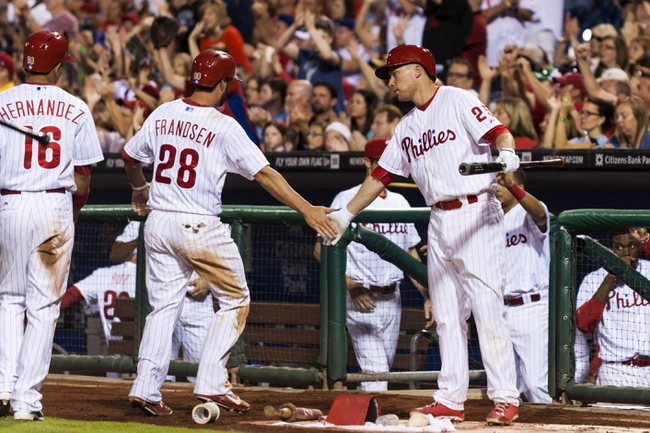 Sep 7, 2013; Philadelphia, PA, USA; Philadelphia Phillies first baseman Kevin Frandsen (28) celebrates scoring with third baseman Cody Asche (25) during the third inning against the Atlanta Braves at Citizens Bank Park. Mandatory Credit: Howard Smith-USA TODAY Sports