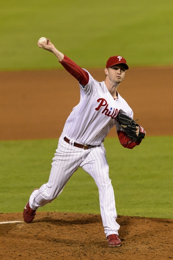 Sep 7, 2013; Philadelphia, PA, USA; Philadelphia Phillies pitcher Kyle Kendrick (38) delivers to the plate during the fourth inning against the Atlanta Braves at Citizens Bank Park. Mandatory Credit: Howard Smith-USA TODAY Sports