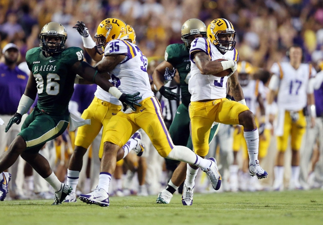 Sep 7, 2013; Baton Rouge, LA, USA; LSU Tigers wide receiver Odell Beckham (3) carries the ball on a punt return against the UAB Blazers during the first quarter at Tiger Stadium. Mandatory Credit: Crystal LoGiudice-USA TODAY Sports