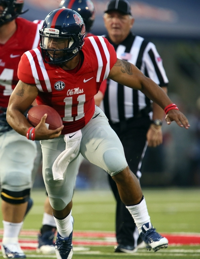 Sep 7, 2013; Oxford, MS, USA; Mississippi Rebels quarterback Barry Brunetti (11) carries the ball up the field during the first half against the Southeast Missouri State Redhawks at Vaught-Hemingway Stadium. Mandatory Credit: Spruce Derden-USA TODAY Sports