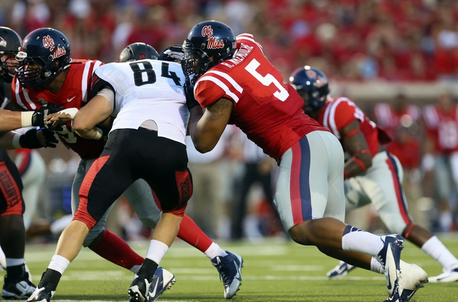Sep 7, 2013; Oxford, MS, USA; Mississippi Rebels defensive end Robert Nkemdiche (5) and Southeast Missouri State Redhawks wide receiver Art Mueller (84) fight for the line during the first half at Vaught-Hemingway Stadium. Mandatory Credit: Spruce Derden-USA TODAY Sports