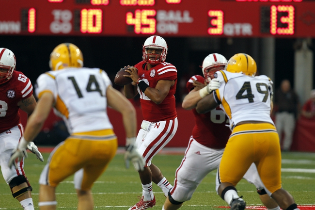 Sep 7, 2013; Lincoln, NE, USA; Nebraska Cornhuskers quarterback Ron Kellogg III looks to throw against Southern Mississippi Golden Eagles in the third quarter at Memorial Stadium. Mandatory Credit: Bruce Thorson-USA TODAY Sports