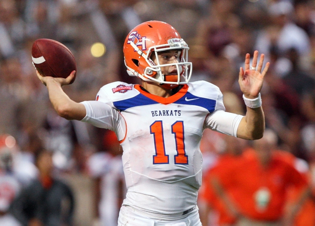 Sep 7, 2013; College Station, TX, USA; Sam Houston State Bearkats quarterback Brian Bell (11) throws a touchdown pass during the second quarter against the Texas A&M Aggies at Kyle Field. Mandatory Credit: Troy Taormina-USA TODAY Sports