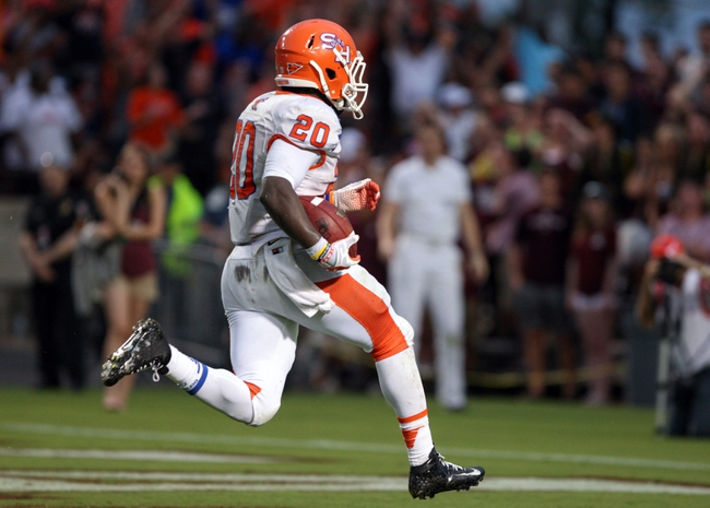 Sep 7, 2013; College Station, TX, USA; Sam Houston State Bearkats running back Timothy Flanders (20) scores a touchdown during the second quarter against the Texas A&M Aggies at Kyle Field. Mandatory Credit: Troy Taormina-USA TODAY Sports