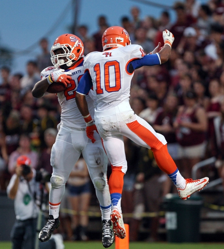 Sep 7, 2013; College Station, TX, USA; Sam Houston State Bearkats running back Timothy Flanders (20) and wide receiver Torrance Williams (10) celebrate after Flanders scores a touchdown during the second quarter against the Texas A&M Aggies at Kyle Field. Mandatory Credit: Troy Taormina-USA TODAY Sports