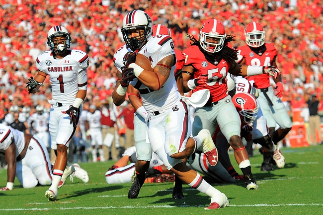 Sep 7, 2013; Athens, GA, USA; South Carolina Gamecocks running back Brandon Wilds (22) runs for a touchdown against the Georgia Bulldogs during the firsts half at Sanford Stadium. Georgia defeated South Carolina 41-30. Mandatory Credit: Dale Zanine-USA TODAY Sports