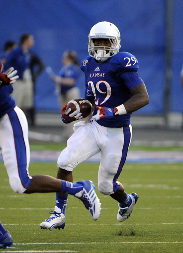 Sep 7, 2013; Lawrence, KS, USA; Kansas Jayhawks running back James Sims (29) carries the ball against the South Dakota Coyotes in the first half at Memorial Stadium. Mandatory Credit: John Rieger-USA TODAY Sports