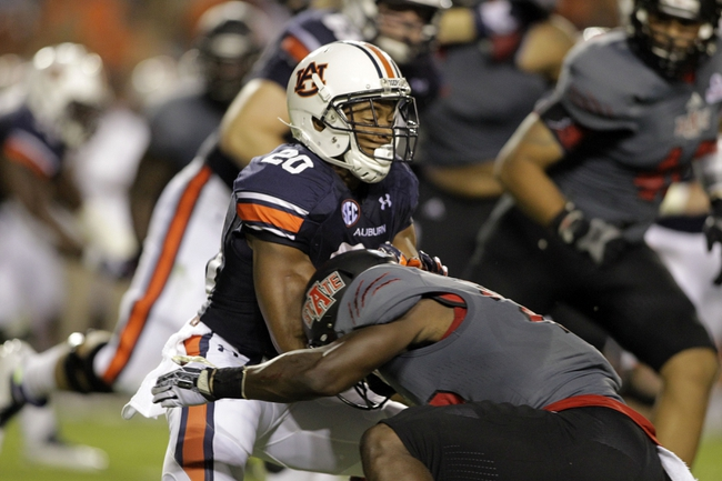 Sep 7, 2013; Auburn, AL, USA; Auburn Tigers running back Corey Grant (20) is tackled by Arkansas State Red Wolves Chris Humes (29) during the first half at Jordan Hare Stadium.  Mandatory Credit: John Reed-USA TODAY Sports