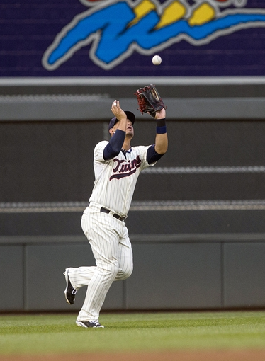 Sep 7, 2013; Minneapolis, MN, USA; Minnesota Twins left fielder Oswaldo Arcia (31) catches a fly ball in the fourth inning against the Toronto Blue Jays at Target Field. Mandatory Credit: Jesse Johnson-USA TODAY Sports