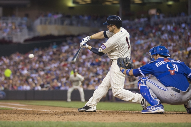 Sep 7, 2013; Minneapolis, MN, USA; Minnesota Twins center fielder Alex Presley (1) hits a single in the fifth inning against the Toronto Blue Jays at Target Field. Mandatory Credit: Jesse Johnson-USA TODAY Sports