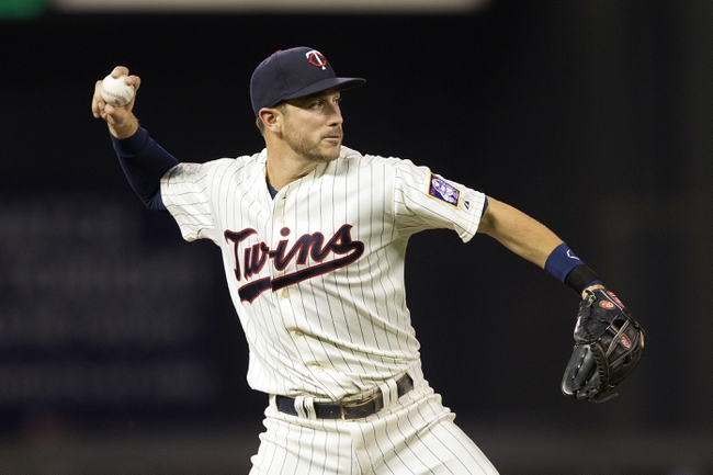 Sep 7, 2013; Minneapolis, MN, USA; Minnesota Twins third baseman Trevor Plouffe (24) throws the ball to first base in the sixth inning against the Toronto Blue Jays at Target Field. Mandatory Credit: Jesse Johnson-USA TODAY Sports