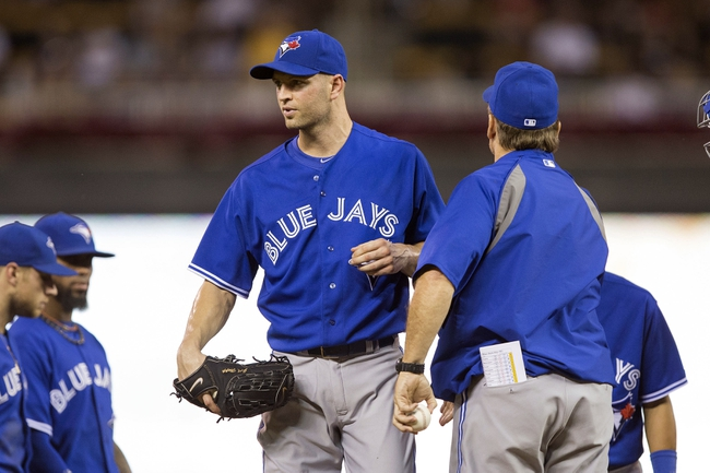 Sep 7, 2013; Minneapolis, MN, USA; Toronto Blue Jays manager John Gibbons pulls starting pitcher J.A. Happ (48) in the sixth inning against the Minnesota Twins at Target Field. Mandatory Credit: Jesse Johnson-USA TODAY Sports