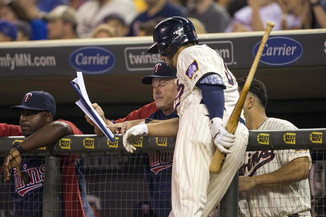 Sep 7, 2013; Minneapolis, MN, USA; Minnesota Twins hitting coach Tom Brunansky talks with first baseman Chris Colabello (55) during the sixth inning against the Toronto Blue Jays at Target Field. Mandatory Credit: Jesse Johnson-USA TODAY Sports