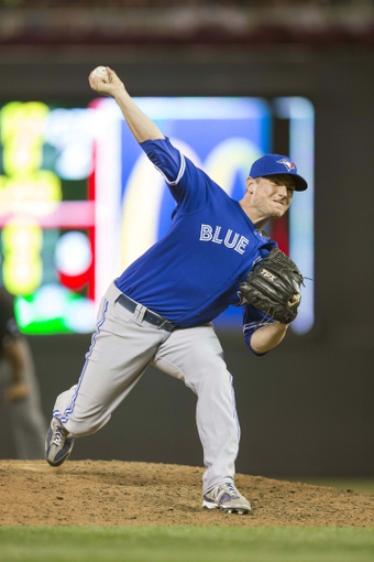 Sep 7, 2013; Minneapolis, MN, USA; Toronto Blue Jays relief pitcher Neil Wagner (45) delivers a pitch in the sixth inning against the Minnesota Twins at Target Field. Mandatory Credit: Jesse Johnson-USA TODAY Sports