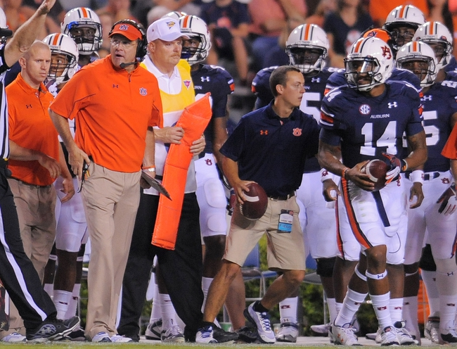 Sep 7, 2013; Auburn, AL, USA; Auburn Tigers head coach Gus Malzahn and Auburn Tigers quarterback Nick Marshall (14) react to a game official during the first half against the Arkansas State Red Wolves at Jordan Hare Stadium. Mandatory Credit: Shanna Lockwood-USA TODAY Sports
