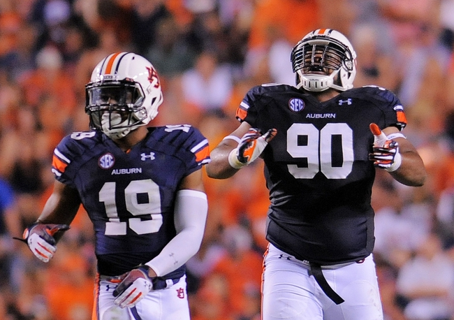 Sep 7, 2013; Auburn, AL, USA; Auburn Tigers defensive back Ryan White (19) and defensive lineman Gabe Wright (90) celebrate a quarterback sack during the first half against the Arkansas State Red Wolves at Jordan Hare Stadium. Mandatory Credit: Shanna Lockwood-USA TODAY Sports