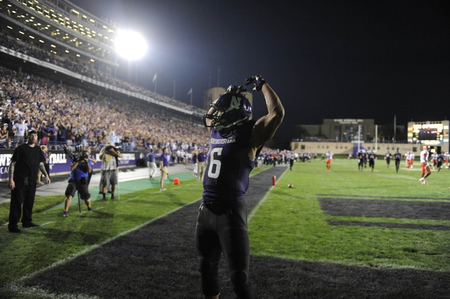 Sep 7, 2013; Evanston, IL, USA; Northwestern Wildcats wide receiver Tony Jones (6) after catching a touchdown pass against Syracuse Orange  during the fourth quarter at Ryan Field. Mandatory Credit: David Banks-USA TODAY Sports