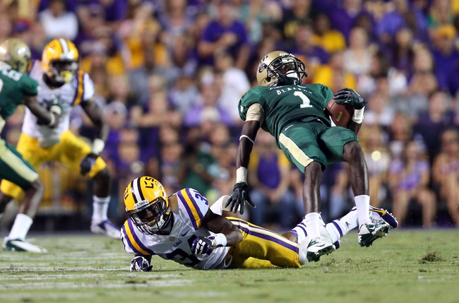 Sep 7, 2013; Baton Rouge, LA, USA; UAB Blazers wide receiver Jamarcus Nelson (1) is tripped up by LSU Tigers safety Micah Eugene (34) in the second quarter  at Tiger Stadium. Mandatory Credit: Crystal LoGiudice-USA TODAY Sports