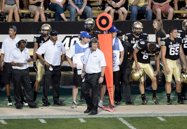 Sep 7, 2013; Boulder, CO, USA; Colorado Buffaloes head coach Mike Macintyre on his sidelines in the second quarter against the Central Arkansas Bears at Folsom Field. Mandatory Credit: Ron Chenoy-USA TODAY Sports