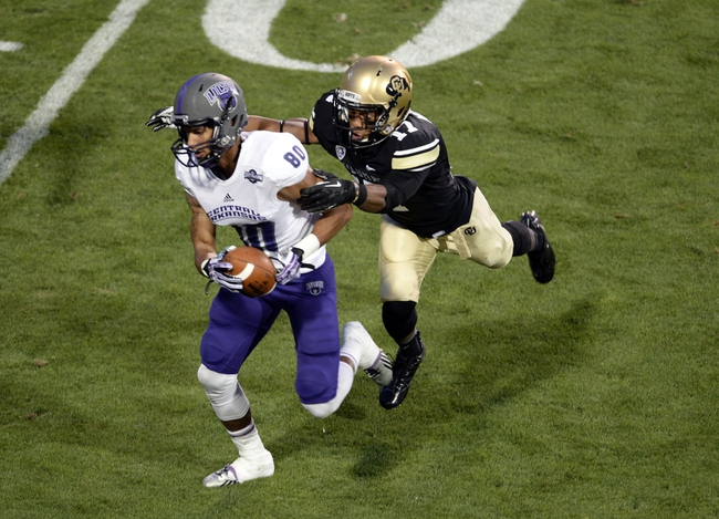 Sep 7, 2013; Boulder, CO, USA; Central Arkansas Bears wide receiver Blake Gardner (80) pulls in a reception as Colorado Buffaloes defensive back Marques Mosley (17) defends late in the second quarter at Folsom Field. Mandatory Credit: Ron Chenoy-USA TODAY Sports