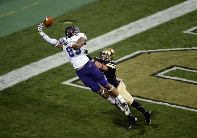 Sep 7, 2013; Boulder, CO, USA; Central Arkansas Bears tight end Chase Dixon (89) pulls in a touchdown pass as Colorado Buffaloes defensive back Parker Orms (13) defends late in the second quarter at Folsom Field. Mandatory Credit: Ron Chenoy-USA TODAY Sports