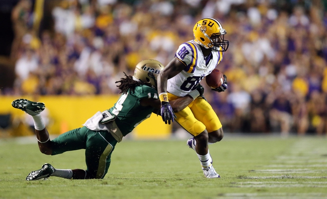 Sep 7, 2013; Baton Rouge, LA, USA; UAB Blazers cornerback Cortez Webb (14) tackles LSU Tigers wide receiver Jarvis Landry (80) as he carries the ball during the second quarter at Tiger Stadium. Mandatory Credit: Crystal LoGiudice-USA TODAY Sports
