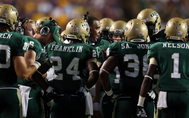 Sep 7, 2013; Baton Rouge, LA, USA; UAB Blazers head coach Garrick McGee talks with his team during a timeout in the second quarter against the LSU Tigers at Tiger Stadium. Mandatory Credit: Crystal LoGiudice-USA TODAY Sports
