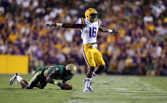 Sep 7, 2013; Baton Rouge, LA, USA; LSU Tigers defensive back Tre'Davious White (16) motions that the pass was no good in front of UAB Blazers wide receiver Jamari Staples (2) during the second quarter at Tiger Stadium. Mandatory Credit: Crystal LoGiudice-USA TODAY Sports