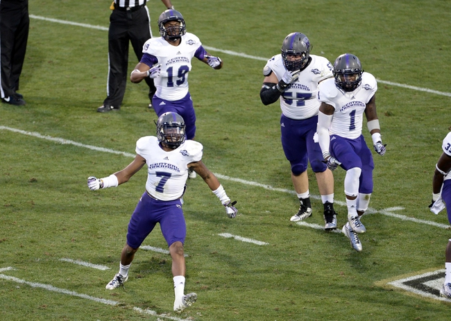 Sep 7, 2013; Boulder, CO, USA; Central Arkansas Bears defensive back Bobby Watkins (7) reacts to his interception in the second quarter against the Colorado Buffaloes Folsom Field. Mandatory Credit: Ron Chenoy-USA TODAY Sports