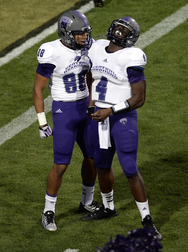 Sep 7, 2013; Boulder, CO, USA; Central Arkansas Bears quarterback Wynrick Smothers (4) reacts with wide receiver Desmond Smith (88) after throwing a touchdown pass late in the second quarter against the Colorado Buffaloes at Folsom Field. Mandatory Credit: Ron Chenoy-USA TODAY Sports