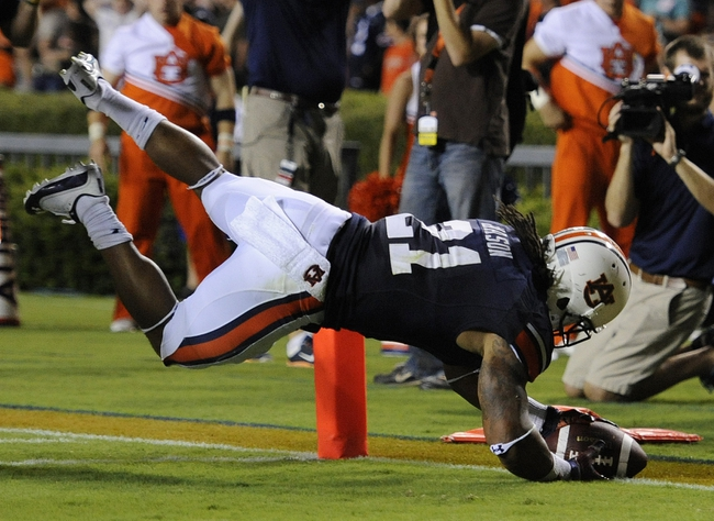 Sep 7, 2013; Auburn, AL, USA; Auburn Tigers running back Tre Mason (21) scores a touchdown in the second half against the Arkansas State Red Wolves at Jordan Hare Stadium. Mandatory Credit: Shanna Lockwood-USA TODAY Sports