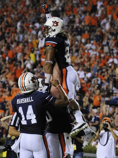 Sep 7, 2013; Auburn, AL, USA; Auburn Tigers running back Tre Mason (21) celebrates his touchdown against the Arkansas State Red Wolves at Jordan Hare Stadium. Mandatory Credit: Shanna Lockwood-USA TODAY Sports