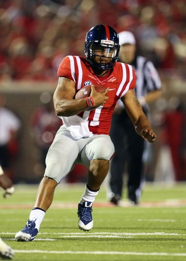 Sep 7, 2013; Oxford, MS, USA; Mississippi Rebels quarterback Barry Brunetti (11) carries the ball up the field during the second half against the Southeast Missouri State Redhawks at Vaught-Hemingway Stadium. Mandatory Credit: Spruce Derden-USA TODAY Sports