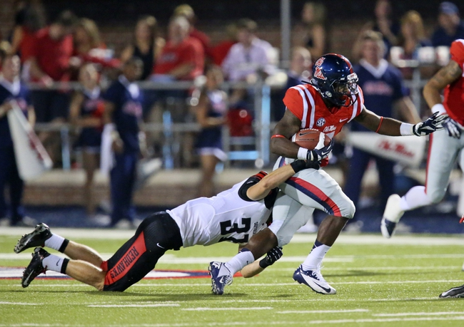 Sep 7, 2013; Oxford, MS, USA; Mississippi Rebels running back Mark Dodson (7) carries the ball up the field while defended by Southeast Missouri State Redhawks fullback Josh Nicks (37) during the second half at Vaught-Hemingway Stadium. Mandatory Credit: Spruce Derden-USA TODAY Sports