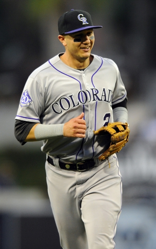 Sep 7, 2013; San Diego, CA, USA; Colorado Rockies shortstop Troy Tulowitzki (2) after making the final out of the fifth inning against the San Diego Padres at Petco Park. Mandatory Credit: Christopher Hanewinckel-USA TODAY Sports
