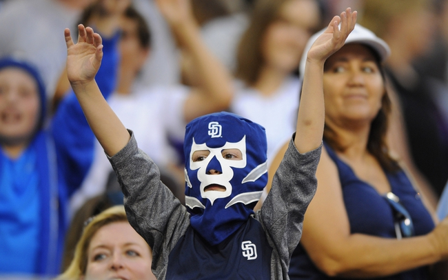 Sep 7, 2013; San Diego, CA, USA; A young San Diego Padres fan waives for a ball on Luchador mask giveaway night against the Colorado Rockies at Petco Park. Mandatory Credit: Christopher Hanewinckel-USA TODAY Sports