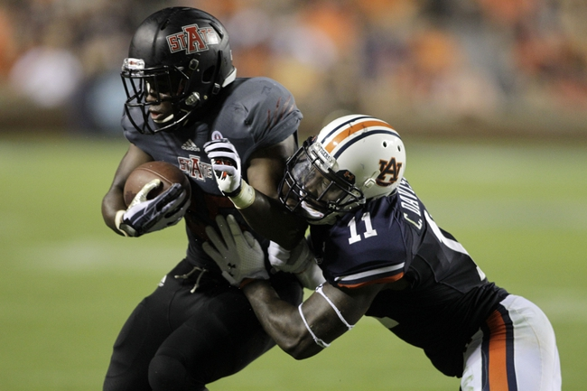 Sep 7, 2013; Auburn, AL, USA; Arkansas State Red Wolves running back David Oku (25) is tackled by Auburn Tigers cornerback Chris Davis (11) during the second half at Jordan Hare Stadium.  Mandatory Credit: John Reed-USA TODAY Sports