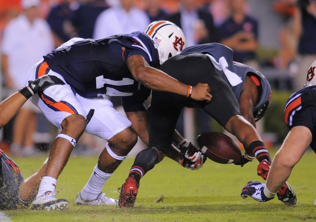 Sep 7, 2013; Auburn, AL, USA; Arkansas State Red Wolves defensive back Artez Brown (10) recovers the fumble by Auburn Tigers quarterback Nick Marshall (14) at Jordan Hare Stadium. Mandatory Credit: Shanna Lockwood-USA TODAY Sports